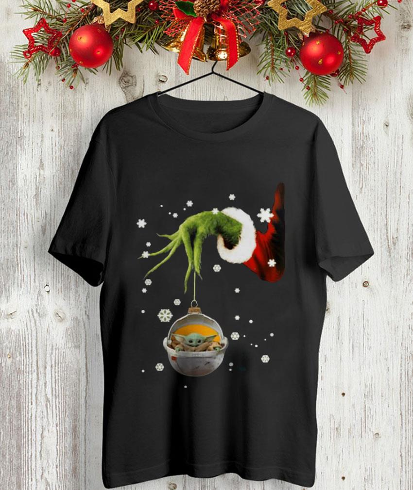 Grinch hand holding Baby Yoda ornament Christmas t-shirt