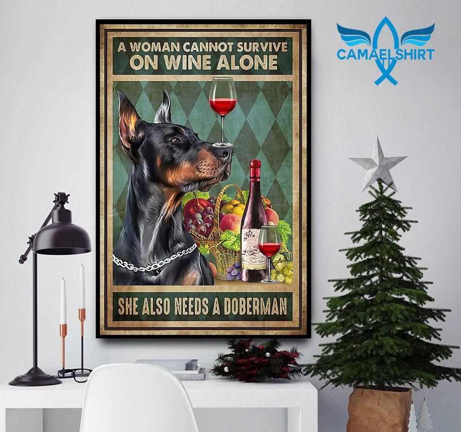 A woman can't survive on wine alone she also needs Doberman poster canvas