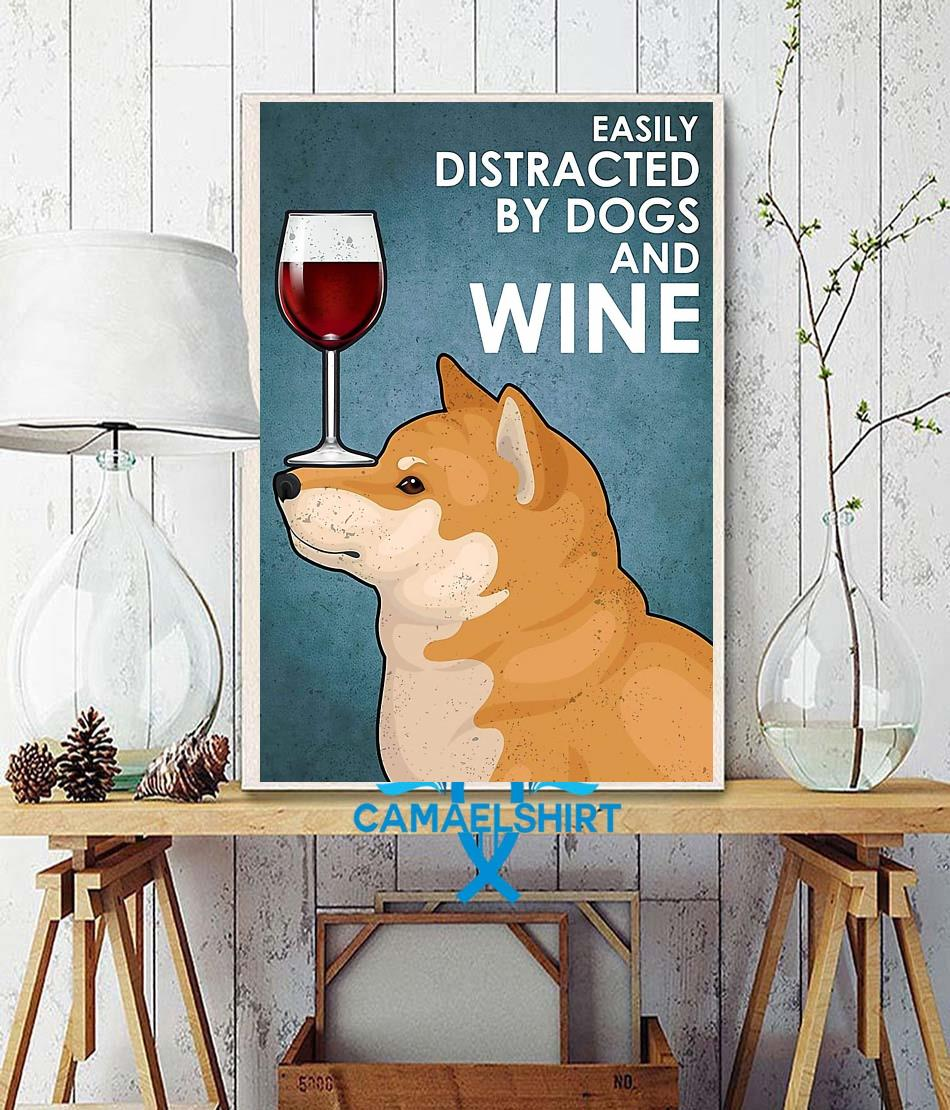 Shiba Inu easily distracted by dogs and wine poster wall decor